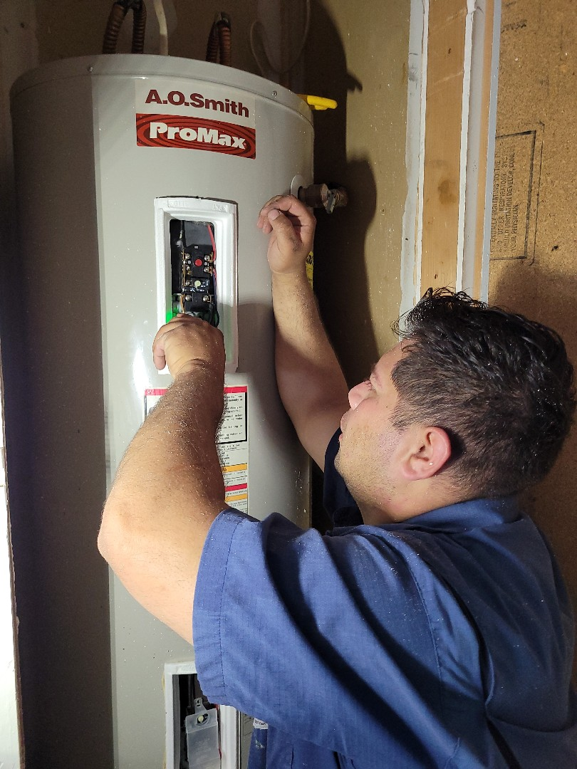 Austin, TX - Danny changing out heater elements. We provide all residential water heater repairs, service and installations.