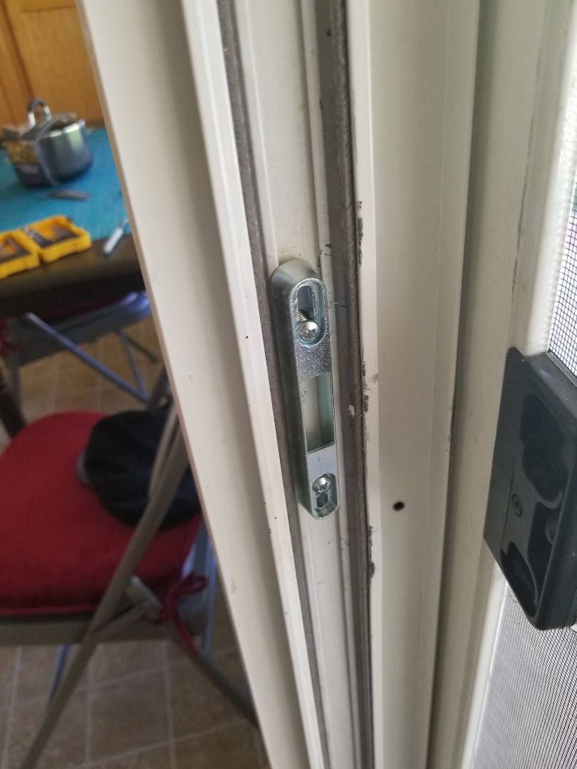 Finished sliding door latch holder installation. The sliding glass door now locks securely! Las Vegas Locksmith service.