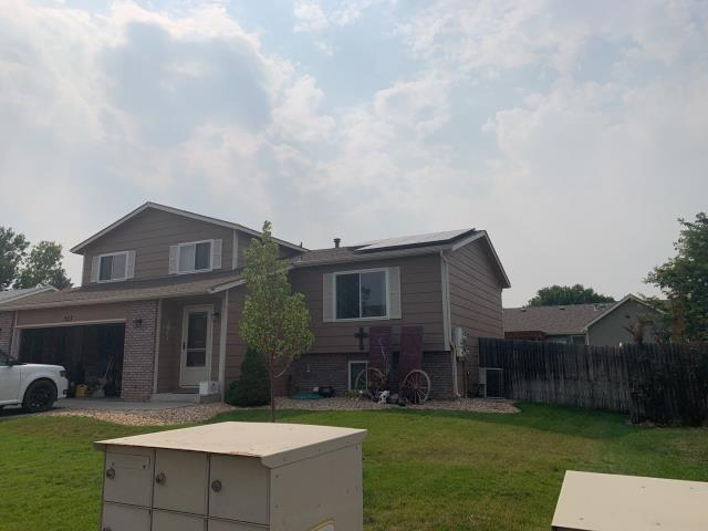 Greeley, CO - Just wrapped up a new roof on this house in Greeley! Time to pick up equipment.