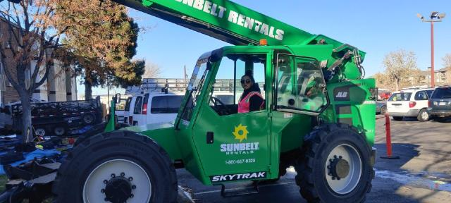 Denver, CO - Yameel is doing awesome operating the fork lift!