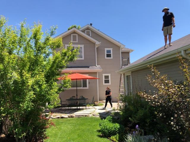 Denver, CO - Working on his roof in Denver today!