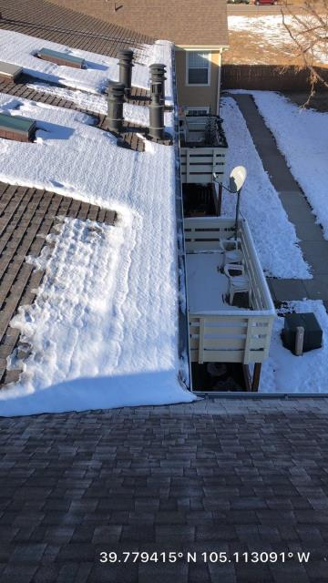 Wheat Ridge, CO - Not easy to perform a roof inspection in the snow, but it's also the most likely time for leaks to show up!
