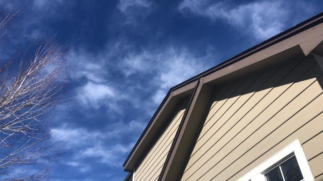 Golden, CO - It's a beautiful day to be up on some roofs! Checking out the blue sky during this repair in Arvada
