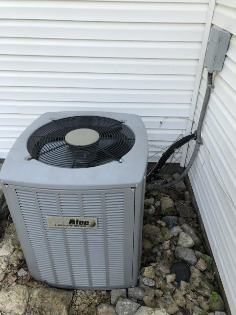 Miamisburg, OH - I arrived on site to perform a tune up on a MacAfee Air Conditioner. During the tune up I found that the unit had a light carbon buildup and was running low voltage. I recommended getting another tune up during the next season to assess the issue further. the unit was running at full functionality at the time of departure.