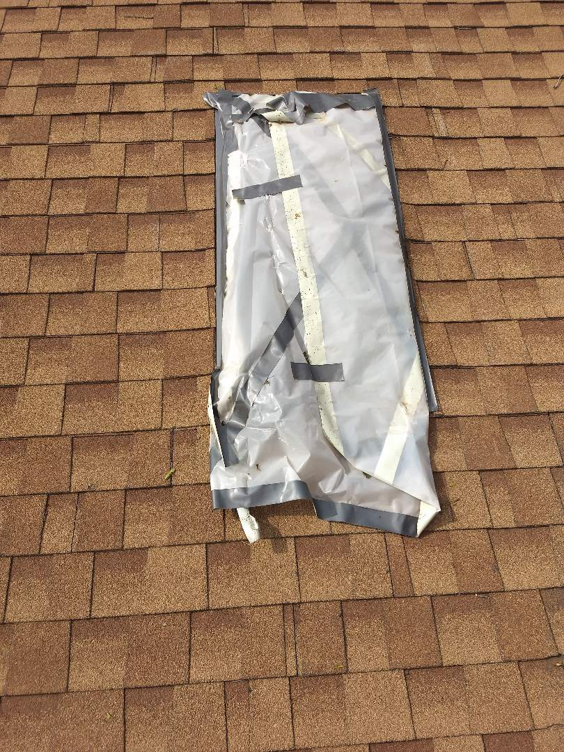 Lubbock, TX - Free roof estimate for hail damage and broken skylight.