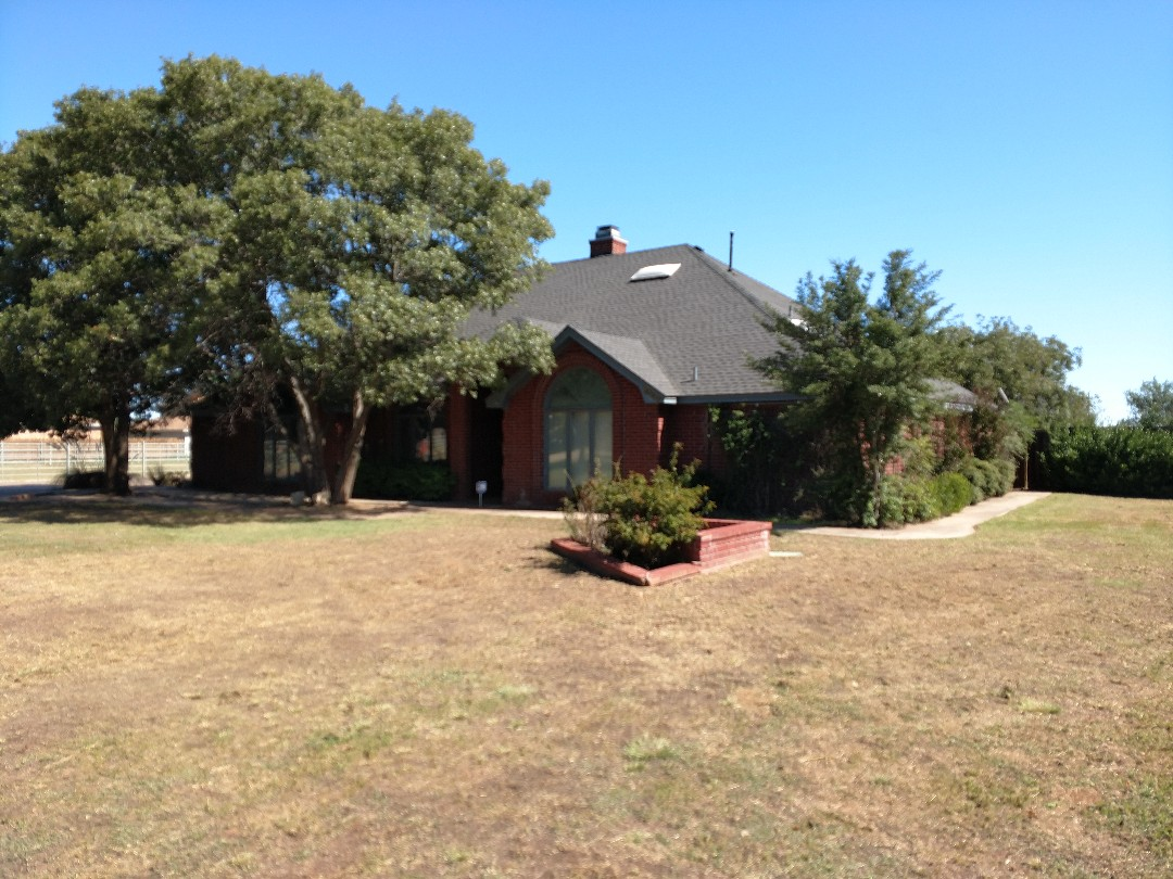 Lubbock, TX - Giving an estimate for a re-roof on a composition shingle roof house, shed and garage also for a metal roof as well.