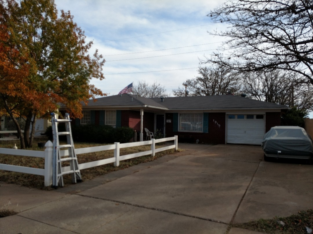 Lubbock, TX - Giving an estimate for a 3 tab composition shingle re-roof.
