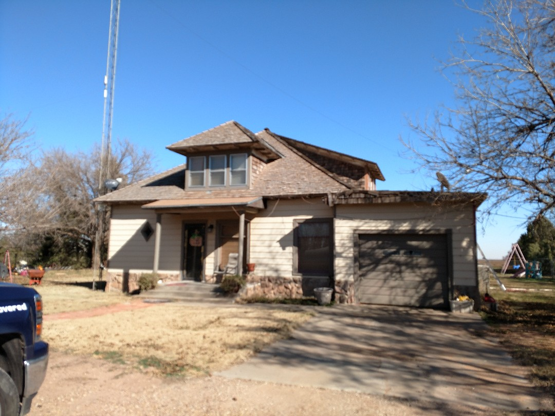 Dimmitt, TX - Giving an estimate for a wood roof removement install rigid insulation, re-roof a flat modified roof system, install a composition roof system.