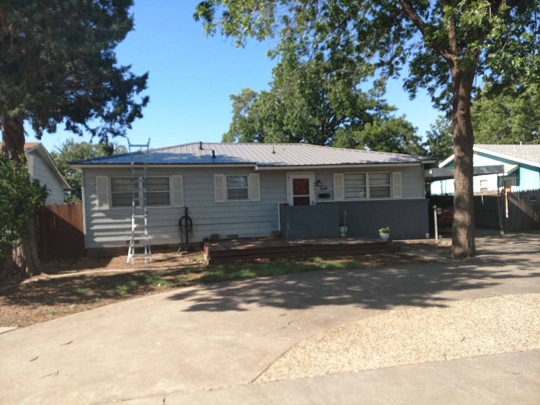 Lubbock, TX - Giving an estimate for a flat porch on a residential home. Estimating a tapered insulation system to give slope and also figuring a modified bitumen system plus a TPO roofing system.