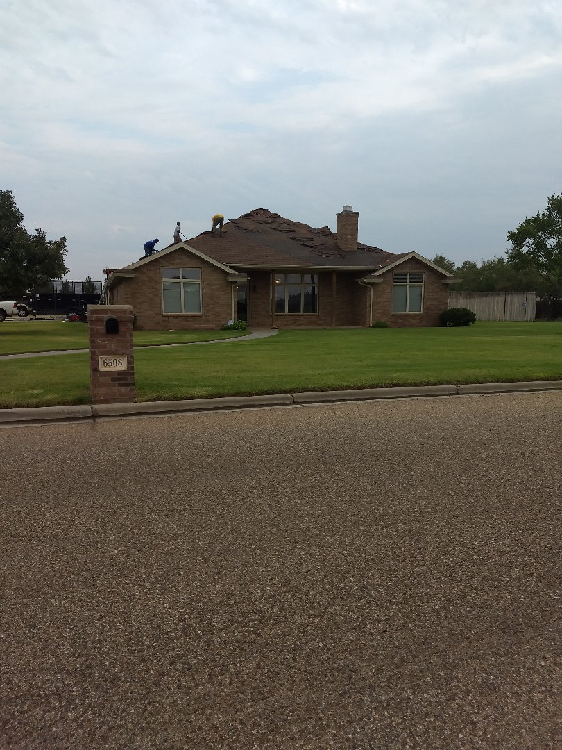 Lubbock, TX - Reroof for customer with ridge ventilation and soffit vents.