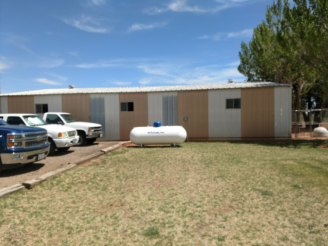 Lubbock, TX - Estimating a metal roof coating system and building a metal carport to one of the metal buildings.