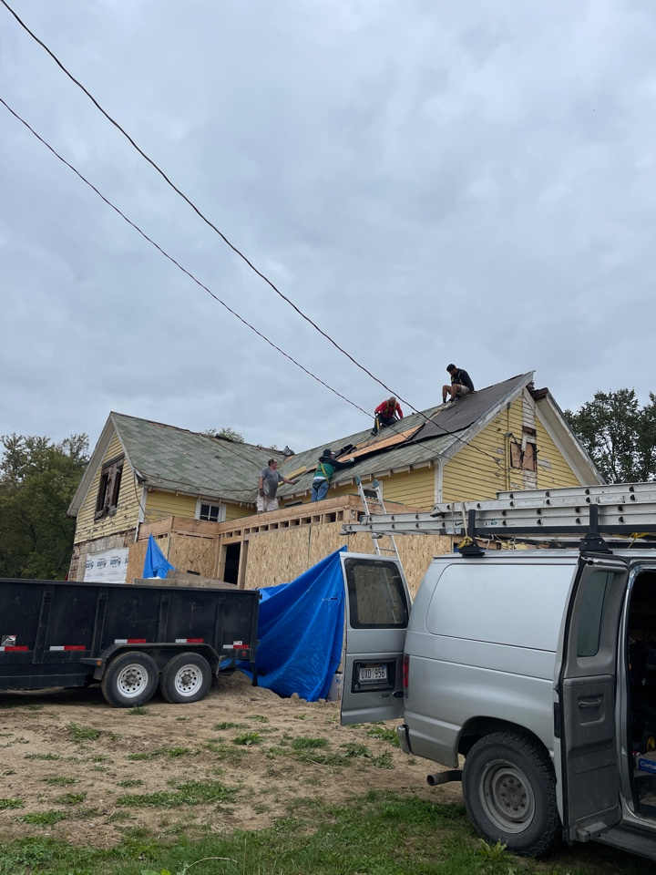 Oakland, NE - Removing top layer of house to rebuild it