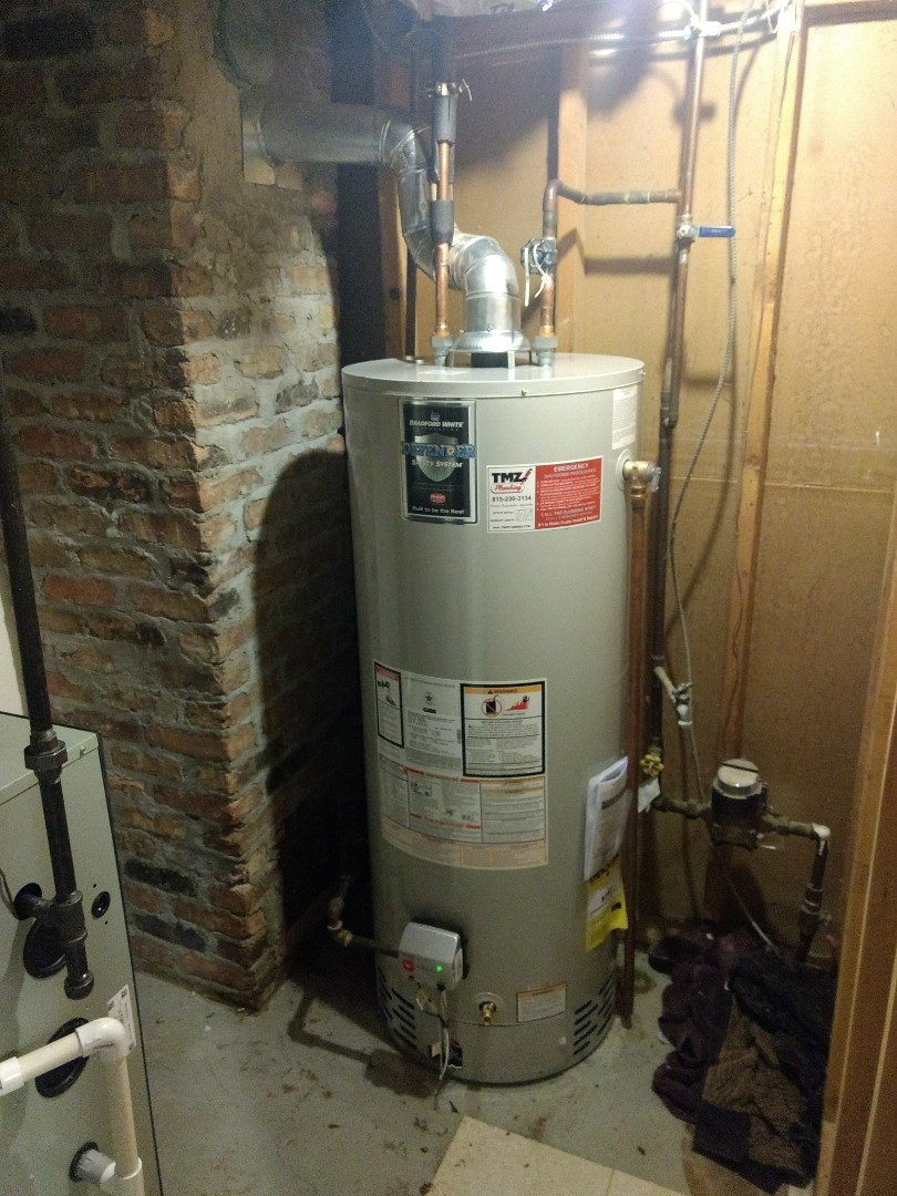Naperville, IL - Install 50 gallon Bradford White natural vent water heater. Repiped gas, water, flue exhaust lines to accommodate size of new heater. Disposed of existing heater.