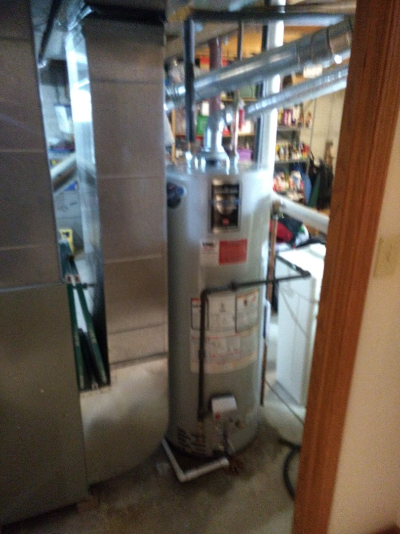 Hinsdale, IL - Installed 50 gallon Bradford White natural vent water heater. Disposed of existing heater. Repiped gas line, replacing illegal packing coupling with genuine coupling.    Installed 3/4 emergency shut off ball valve on water heater feed.