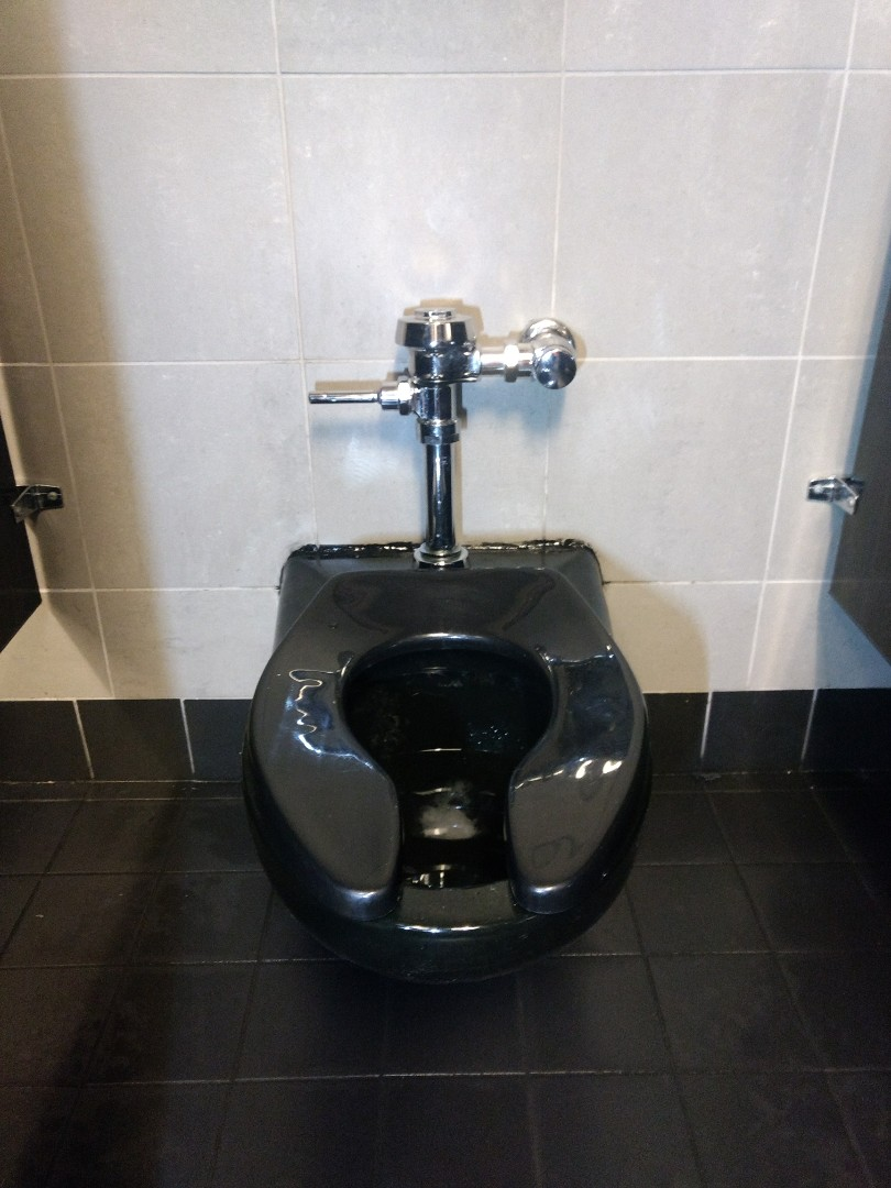 Joliet, IL - Reset wall mounted commercial toilet and replaced neoprene gasket. Reassembled flush valve and set flush level to proper amount.  Rodded drain with quarter-inch drill powered rod.