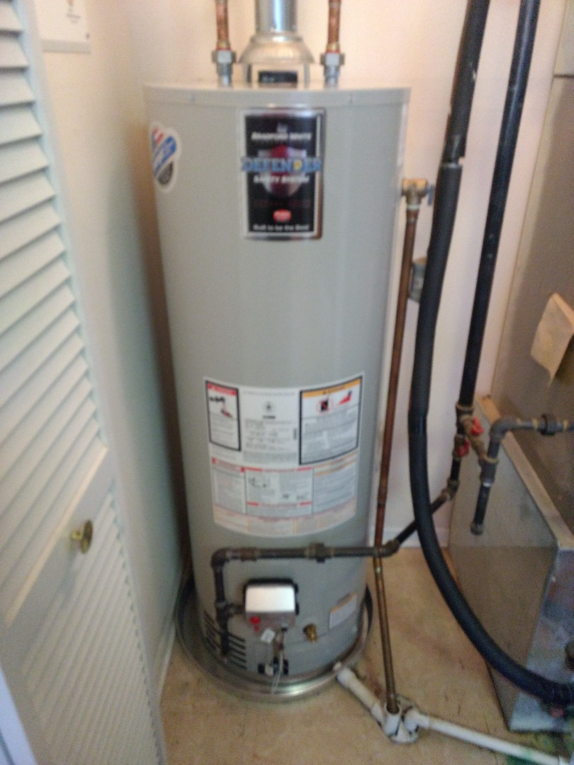 Crest Hill, IL - Installed 40 gallon Bradford White natural vent water heater. Installed new 22 inch drain pan, and piped 1 inch PVC to floor drain. Hard piped dip tube to floor drain. Repiped gas, water, and flue exhaust lines to accommodate size of new heater.