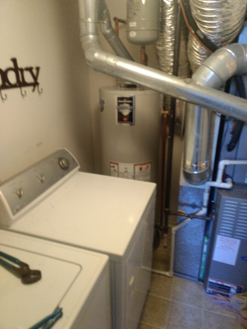 Plainfield, IL - Installed 40 gallon Bradford White natural vent water heater. Disposed of existing heater. Repiped water, gas, flue exhaust piping to accommodate size of new heater. Installed drain pan.