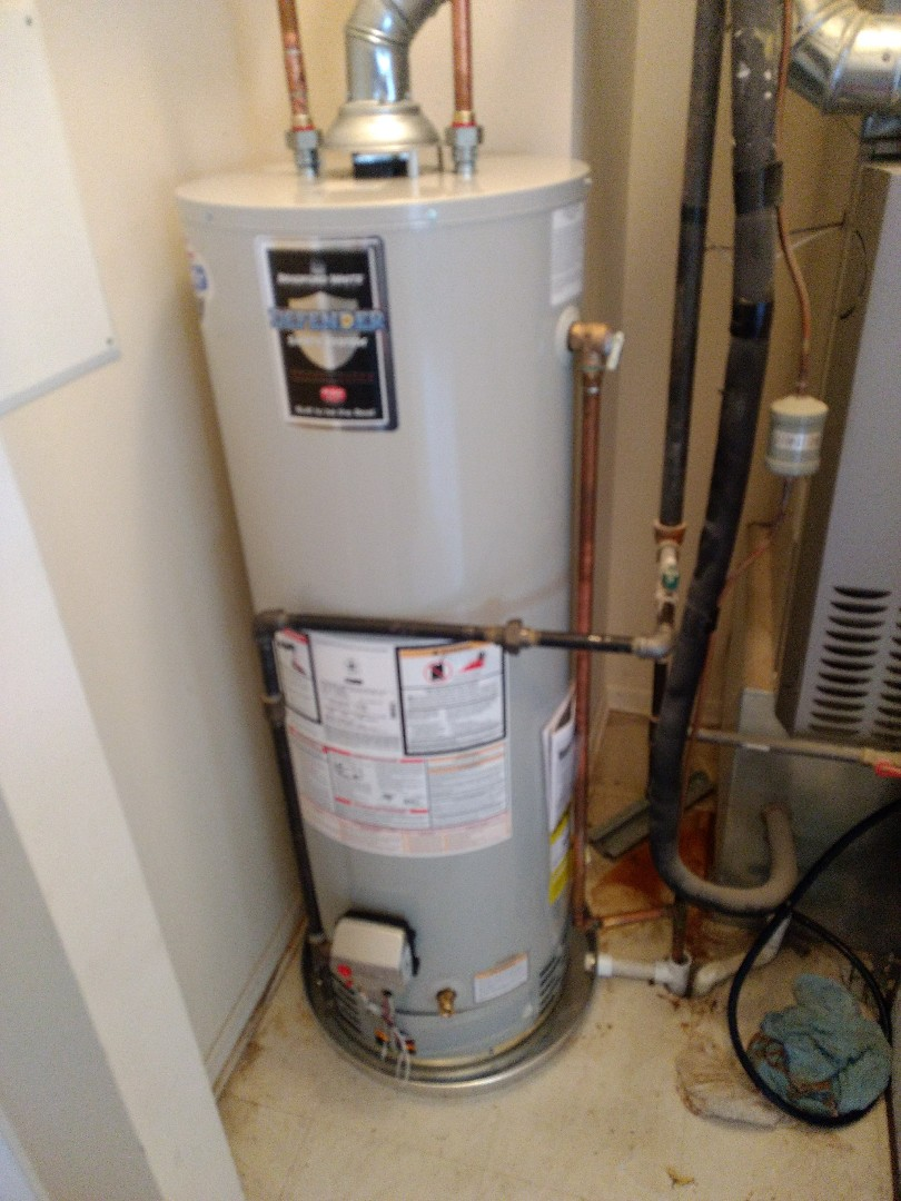 Crest Hill, IL - Installed 40 gallon Bradford White natural vent water heater. Disposed of existing heater. Repiped water, gas, flue exhaust, t&p dip tube, and drain pan waste line. Installed new drain pan.
