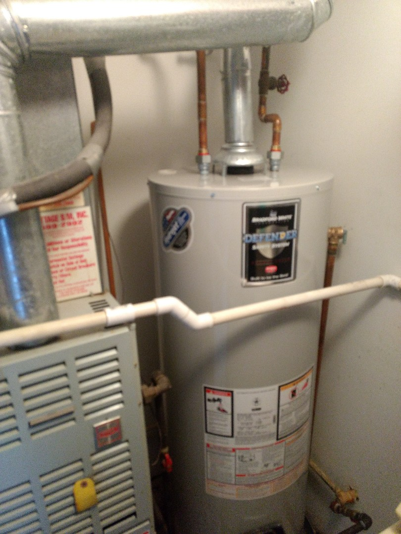 Crest Hill, IL - Installed 40 gallon Bradford White natural vent water heater. Install drain pan. Repiped water, gas, flue exhaust to accommodate new heater. Joliet