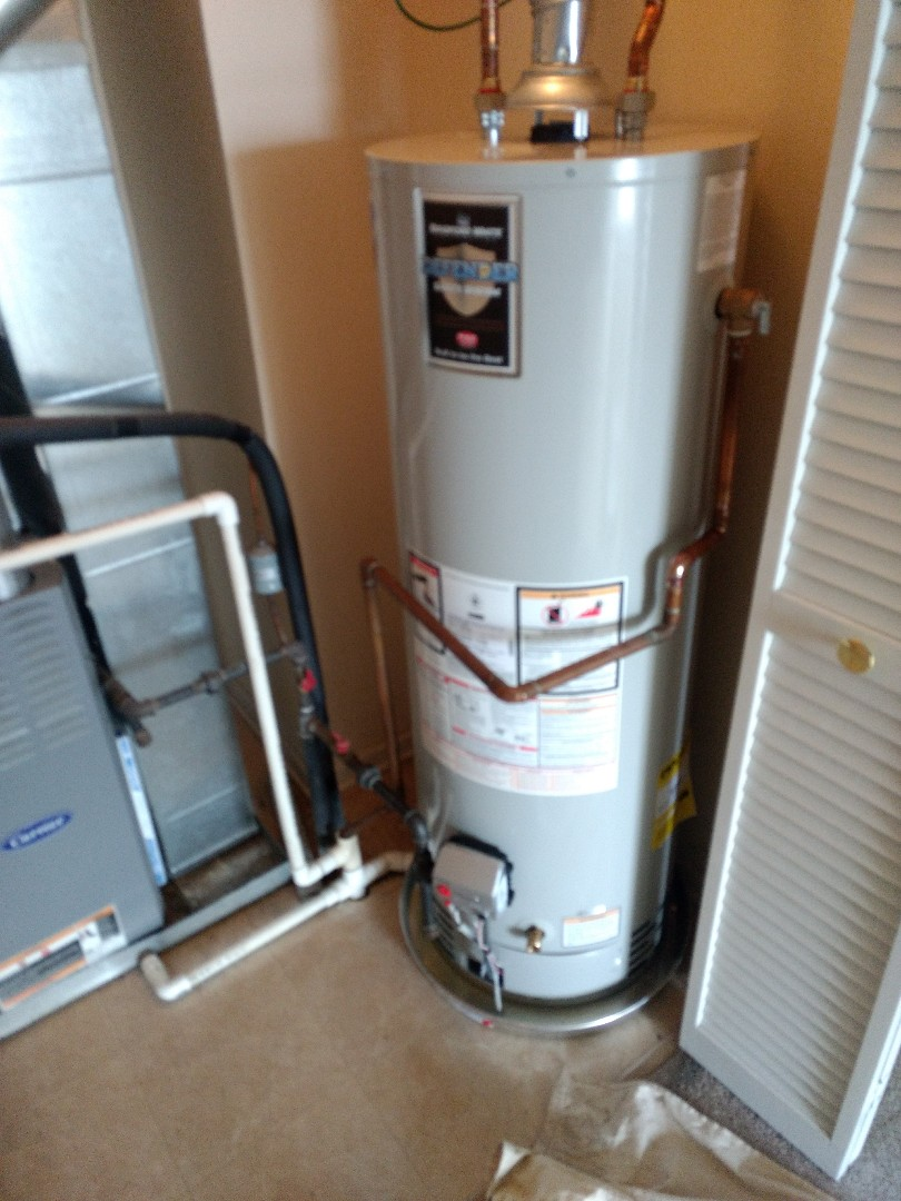 Crest Hill, IL - Installed 40 gallon Bradford White Water Heater in Crest Hill. Installed drain pan and ran dip tube into floor drain.