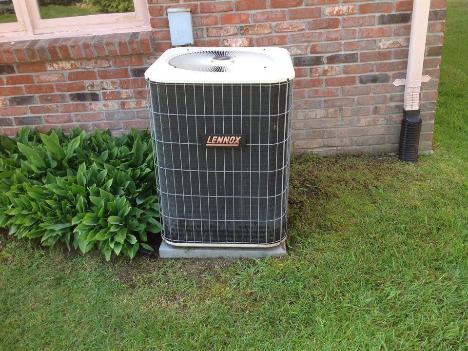 Utica, MI - Service on a residential Lennox air conditioner in Shelby township.