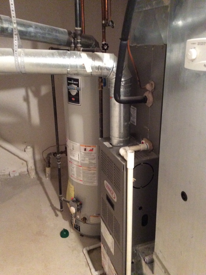 Utica, MI - Furnace inspection on a Lennox furnace. Water heater inspection on a Bradford White water heater. Replaced pad and checked operation of a April Air humidifier.