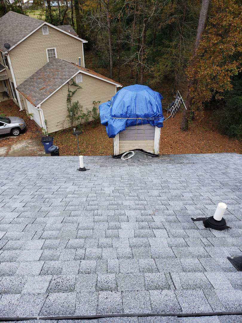Evans, GA - Replacing leaking chimney chase cap on a residential home in evans Georgia with South Point Roofing and Construction