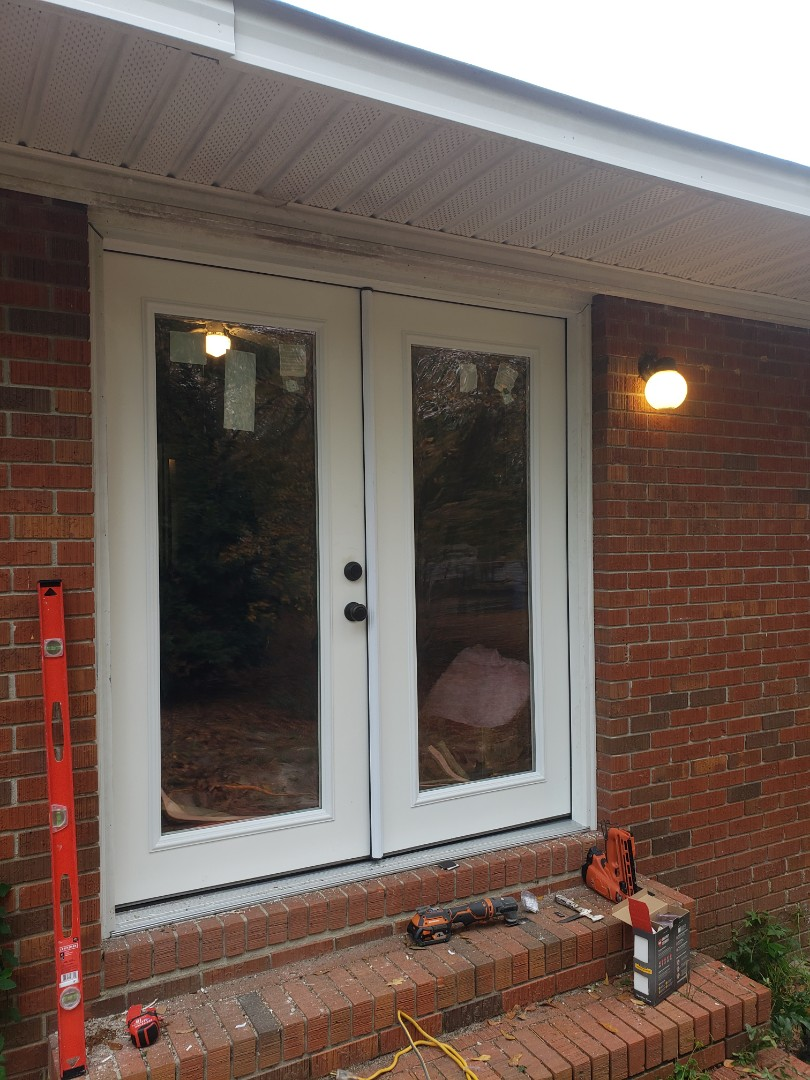 Warrenville, SC - Replacing a sliding door with new fiberglass French door in Warrenville with South Point Roofing and Construction
