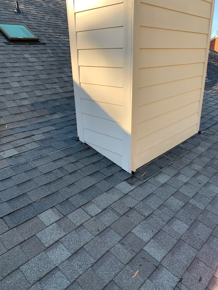 Augusta, GA - South Point Roofing and Construction is repairing a leaking chimney on a residential roof in Augusta, GA.