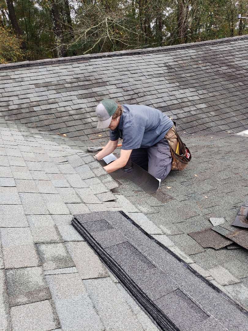 Warrenville, SC - South Point Roofing and Construction repairing architectural asphalt shingle residential roof leak near plumbing vent and also installing new six inch seamless gutters in Gloverville, SC.