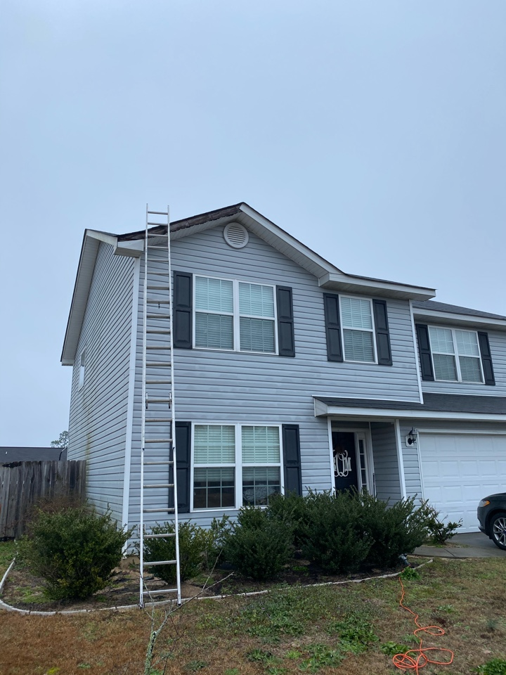 "Aiken, SC - South Point Roofing and Construction installing new 6"" seamless gutters along with repairing Fascia medal blown off of house in Trolly Run neighborhood in Aiken SC"