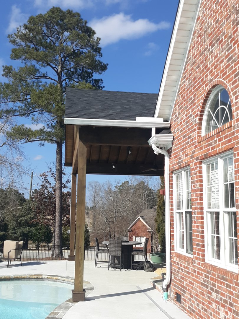 Evans, GA - South Point Roofing and Construction is installing 6 inch white seamless gutter in Evans, GA