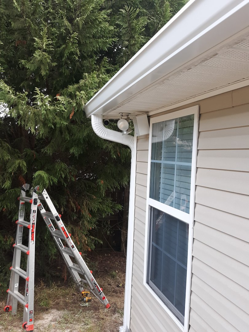 North Augusta, SC - Residential roofer South Point Roofing and Construction is installing 6 inch white seamless gutter in North Augusta, SC to help prevent damage to flower beds.