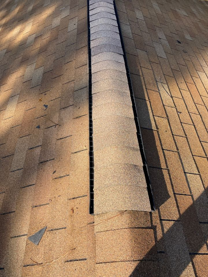 Aiken, SC - SPRC repairing wind damaged shingles on ridge of home using new Oak Ridge shingles, in Aiken SC