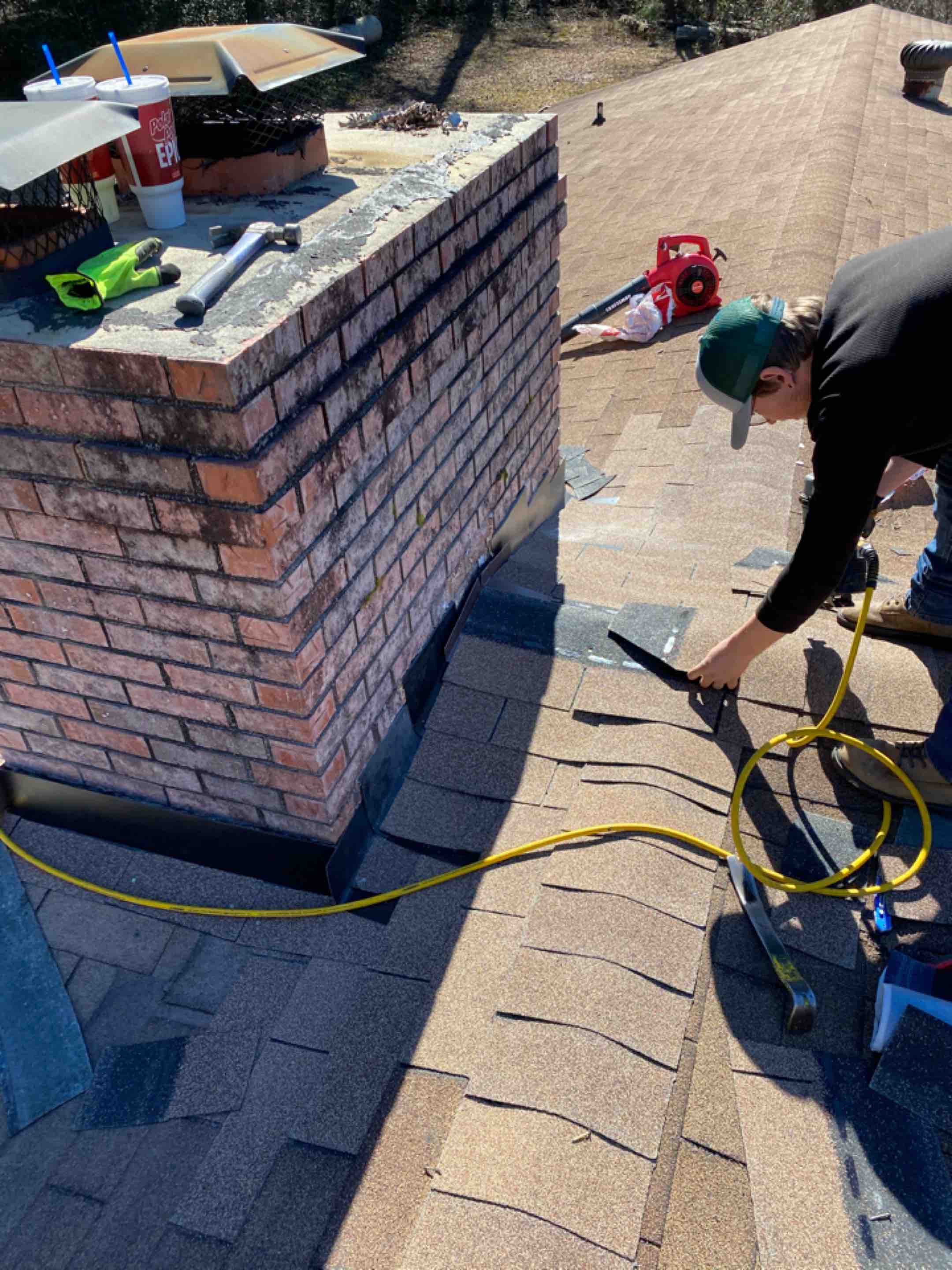 Aiken, SC - South Point Roofing And Construction repairing leak caused by poor chimney flashing, using new Oak Ridge 3 Tab shingles in Aiken SC