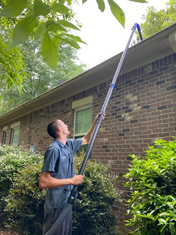 Aiken, SC - South Point Roofing and Construction cleaning out gutters as well as repairing roof leaks cause by storm collars on heat stacks in Woodside Plantation in Aiken SC