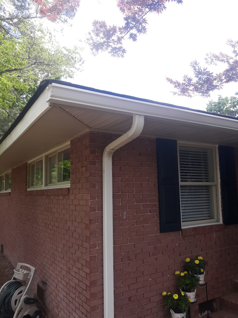 Aiken, SC - South Point Roofing and Construction is installing 6 inch white seamless gutter in Aiken, SC.