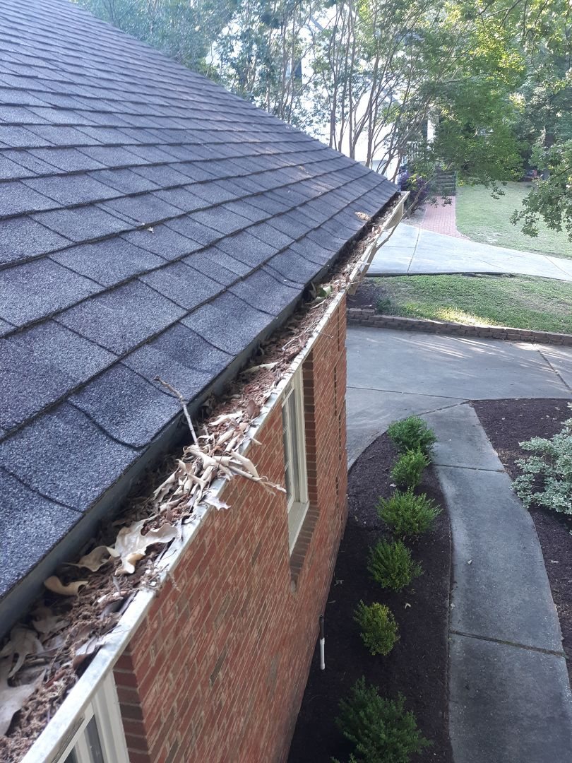Aiken, SC - South Point Roofing and Construction is cleaning out gutters in Aiken, SC.