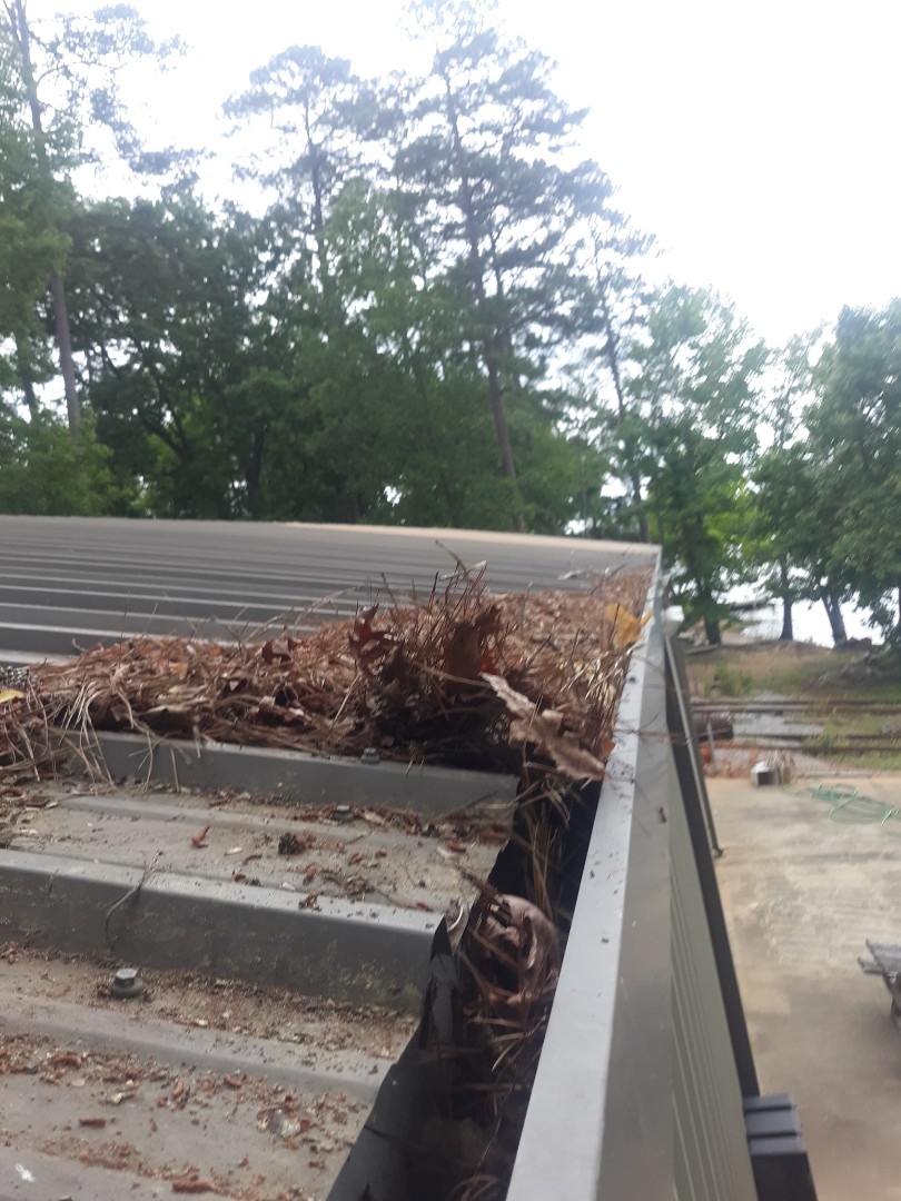 , SC - South Point Roofing and Construction is cleaning out gutters on a metal shop in Batesburg, SC.
