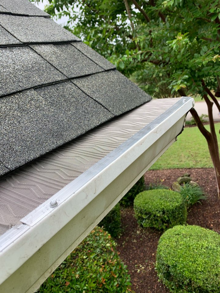 """Aiken, SC - South Point Roofing and Construction is installing new Leaf Blaster Pro gutter guards as well as replacing old helmet-style gutters with new 6"""" seamless K-Style gutters."""