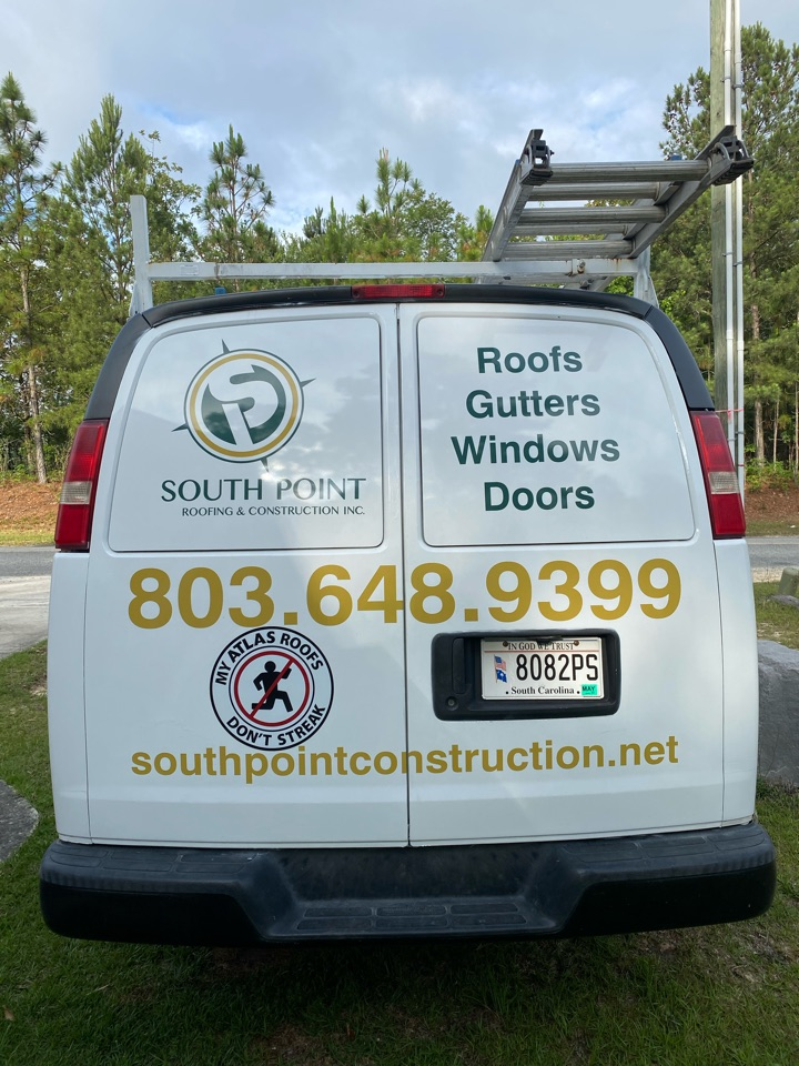 """West Columbia, SC - South Point Roofing and Construction installing new 6"""" seamless gutter on residence in West Columbia SC"""