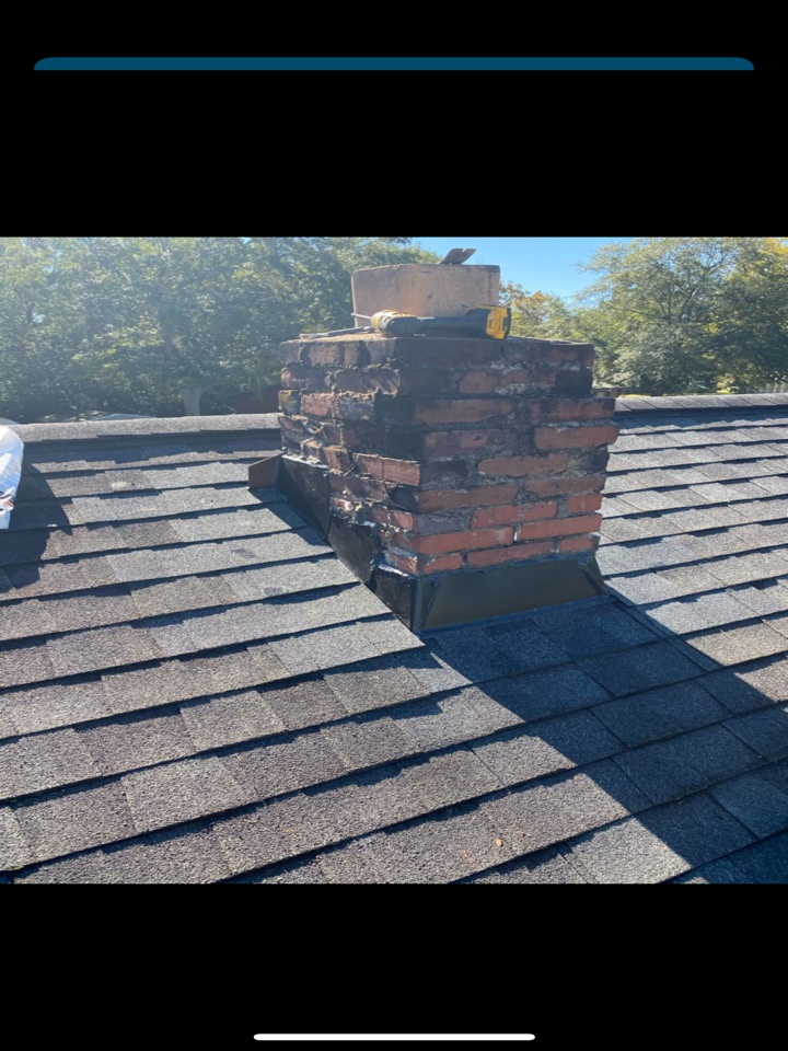West Columbia, SC - South Point Roofing and Construction repairing a roof leak caused by poor chimney flashing @ residence in West Columbia SC