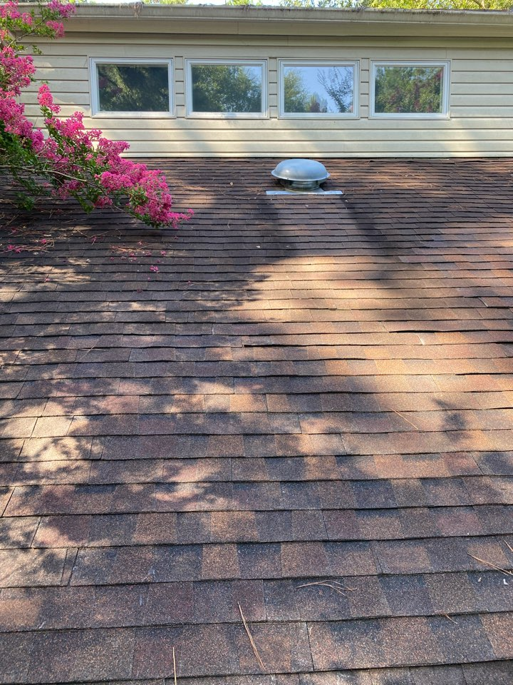 Aiken, SC - South Point Roofing and Construction repairing roof leak caused by damaged shingles in Aiken SC