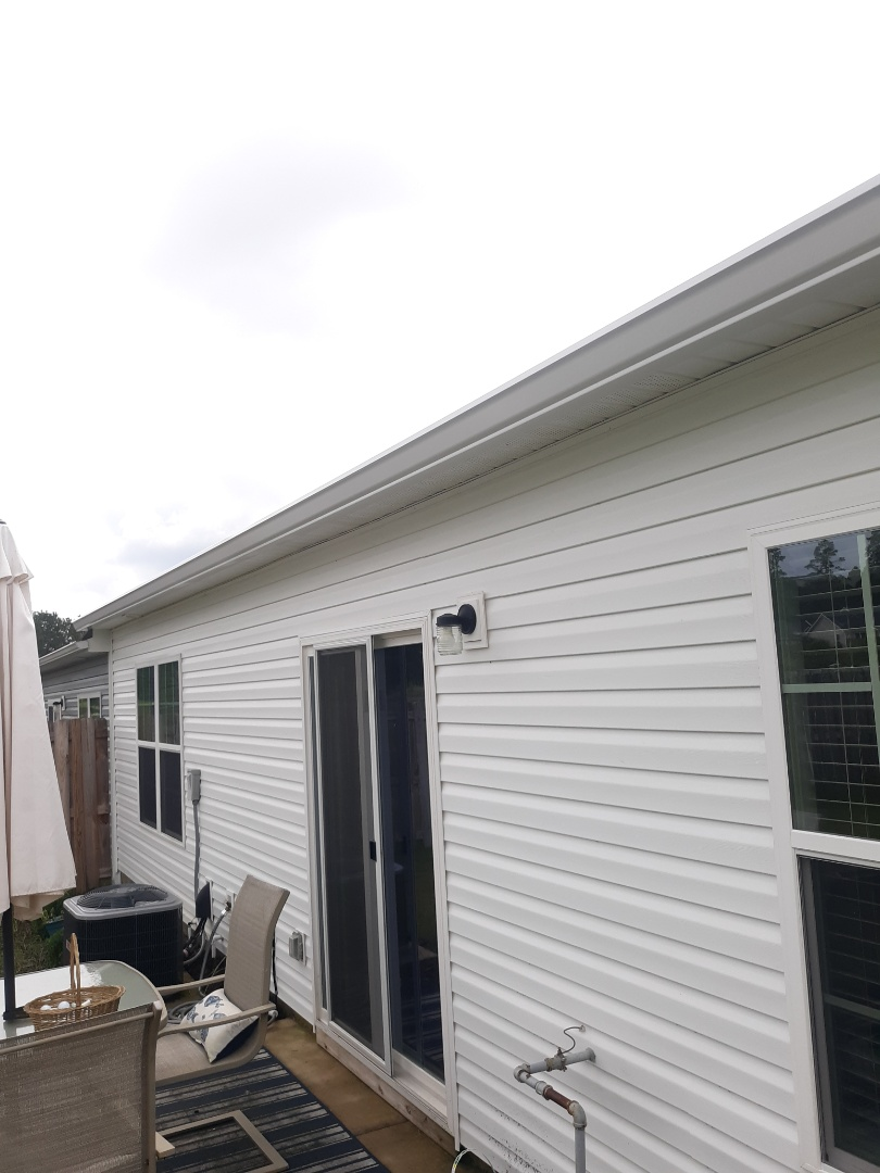Aiken, SC - South Point Roofing and Construction is installing 6 inch white seamless gutter in Vaucluse, SC.