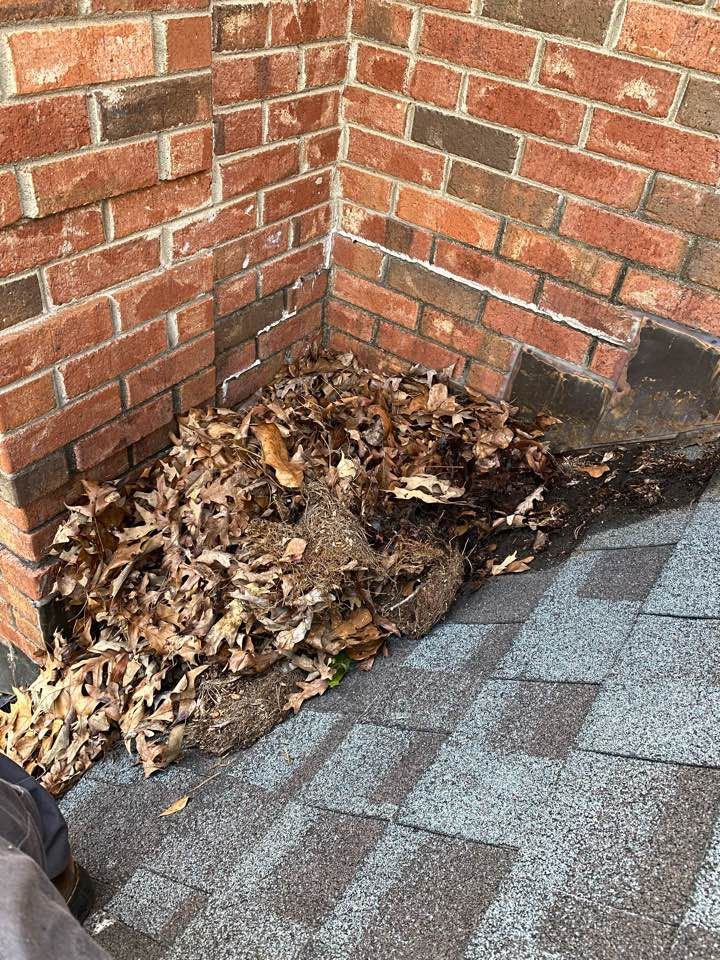 Aiken, SC - Debris is so detrimental to the functionality of your roof and gutters! Join our Overhead Care Club today and we will not only help maintain your roof and gutters, but members get other perks as well!  You don't have to be a member, however, to get help!  In this photo, South Point Roofing and Construction is blowing off debris from a roof as well as addressing sealants in Aiken, SC.  For more information, call 803-648-9399 or visit our website www.southpointconstruction.net
