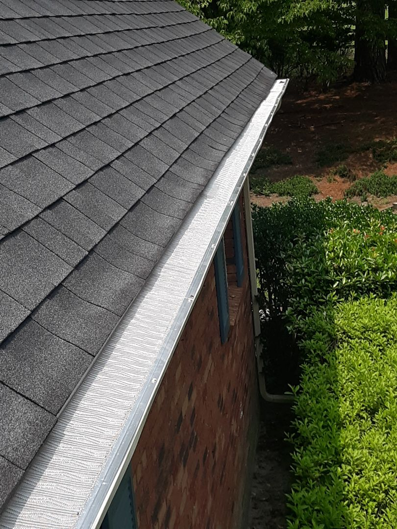 Aiken, SC - Trees are wonderful for your yard, but not so much for your gutters!  If you have trees, protect your gutter investment with gutter guards.  Here, South Point Roofing and Construction is installing LeafBlaster pro gutter guards in Aiken, SC. Call the Pros Who Know! 803-648-9399
