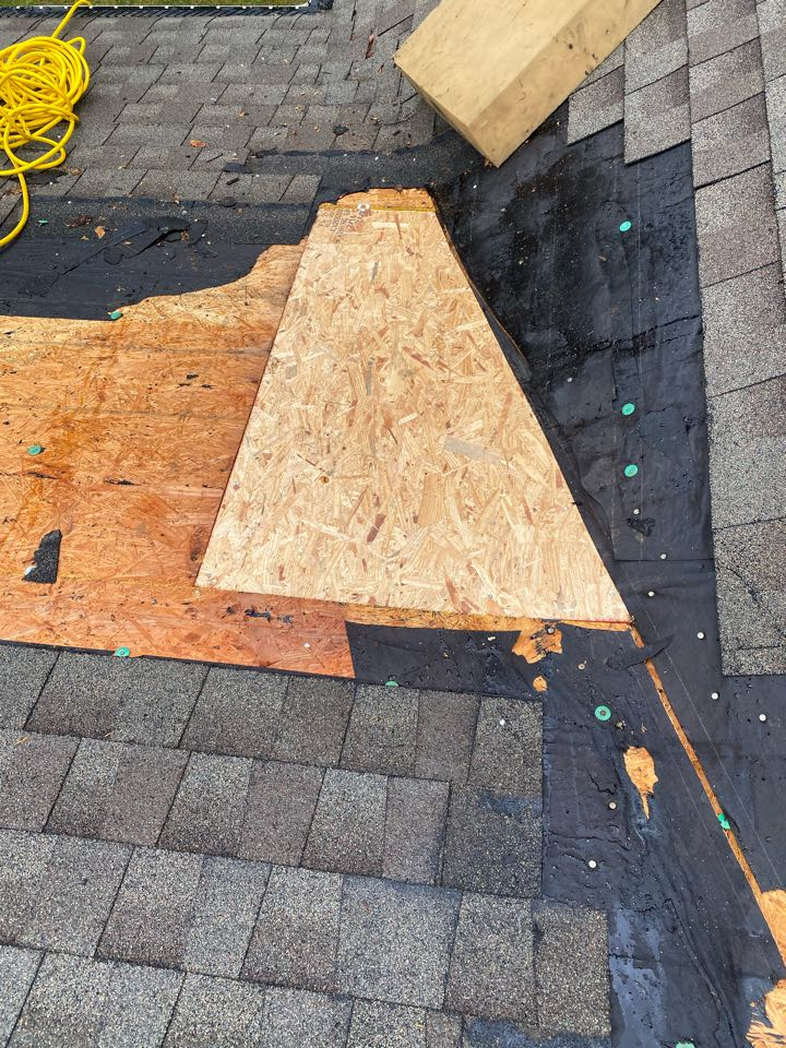 Aiken, SC - South Point Roofing and Construction repairing roof leak caused by damaged shingles in valley. In Aiken SC