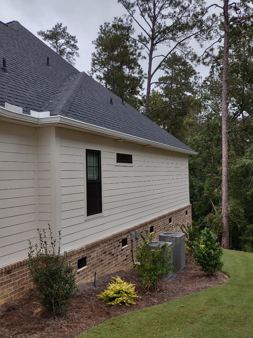Aiken, SC - South Point Roofing and Construction is installing 6 inch white seamless gutter in Woodside Plantation in Aiken, SC.