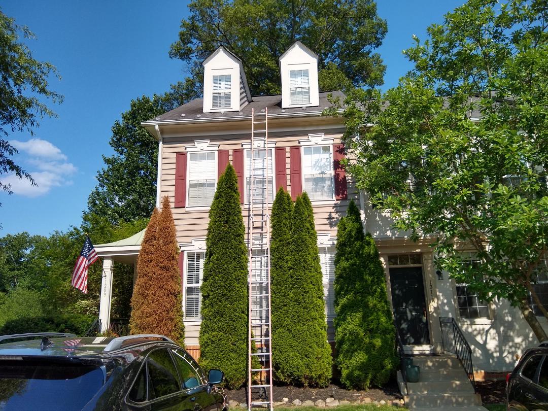 Reston, VA - Providing an estimate in Reston, VA. We specialize in high and steep roofs.