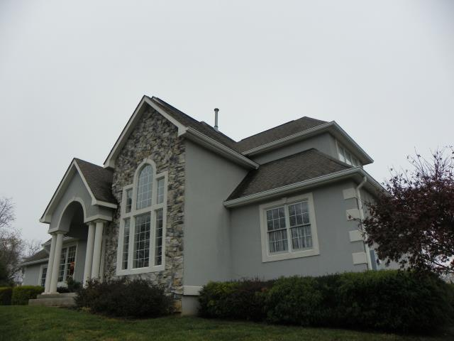 Warrenton, VA - Replaced the hip roof on this beautiful stone front home.